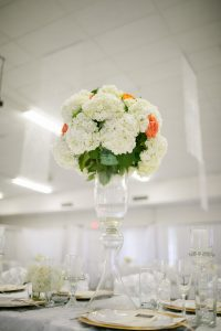 orange and white rose floral arrangement